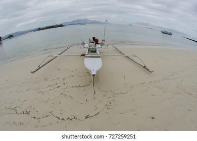 boat in the beach of saronde islans, gorontalo Indonesia. A veri beutiful white sand beach. Saronde Island located in Gorontalo Province in Sulawesi Indonesia.