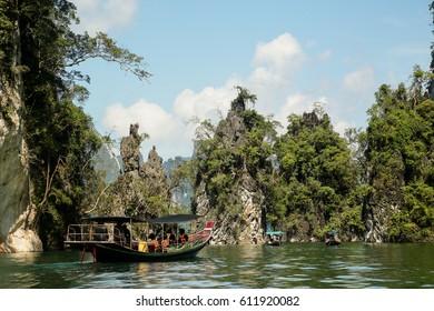 Boat between cliffs in khao sok park