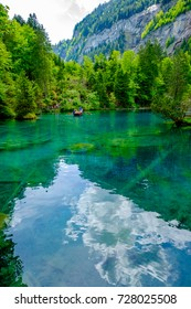 boat in Blausee the blue lake in Switzerlabd