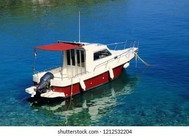 boat in the blue water of the island Losinj, Croatia