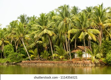 Boat builder small hut on the shores of Kannur canals, Kerala, India