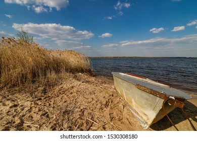 Boat by the lake on the beach.