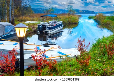Boat was by river. Several rowing boats are moored. River turns into a large lake. Boat dock in autumn day. Concept - eco tourism. Boats for eco tourist class. Lanterns by the coast river.