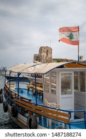 a boat in Byblos with lebanese flag on top, Lebanon
