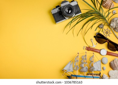 Boat, camera and palm tree on yellow background. Summer holidays, seaside resort. Cruise ship vacation concept.