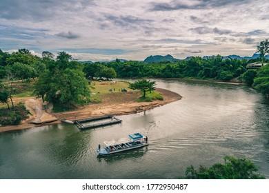 Boat and camping nearby river at Tham Krasae cave Kanchanaburi province Thailand