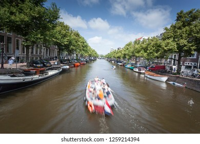 Boat at the canal of Amsterdam Netherlands stock photo.