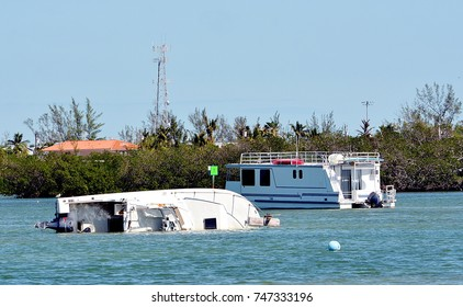 A boat is capsized and sinking after Hurricane Irma, in Key West, Florida.
