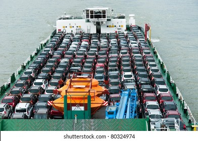 Boat carries a lot of cars to market