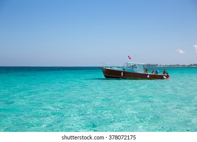 Boat in Cayman Island's crystal clear waters.