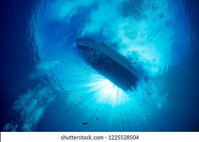 boat chain anchor from underwater with sun rays