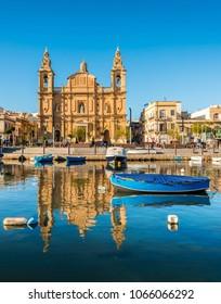 Boat and church in Sliema, Malta