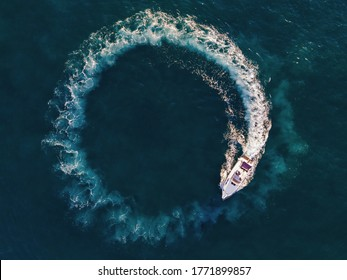 boat circle in mediterranean sea - italy