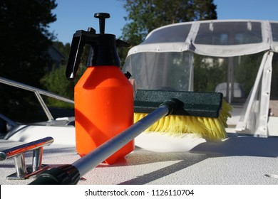 Boat cleaning with brush and pump spray bottle