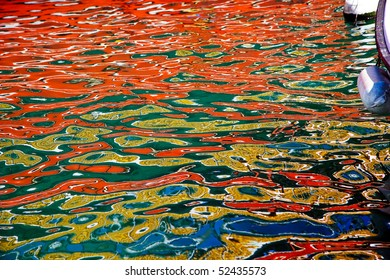 Boat color is reflected on the surface of the sea. Island Krk, Croatia.