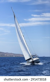 Boat competitor of sailing regatta, clear sunny weather. Luxury yachts.
