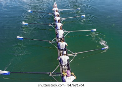 Boat coxed eight Rowers training rowing on the lake