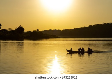 Boat crossing the Amazon in Brazil at sunset.