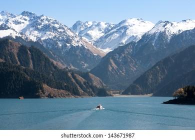 A boat cruise at Heavenly lake, Xinjiang Tianshan, China