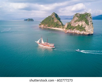 Boat cruising around the Five Islands, Aerial drone photo tropical turquoise water Koh Samui Island, Thailand