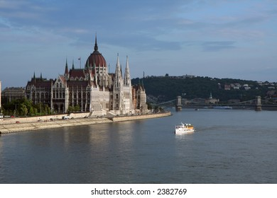 Boat cruising in front of the Parliament House (Budapest, Hungary)