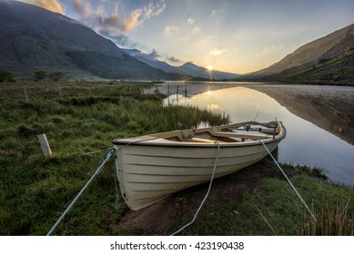boat at Cummenduff lake,surrounded by mountains in The Black Valley, Co.Kerry, Ireland