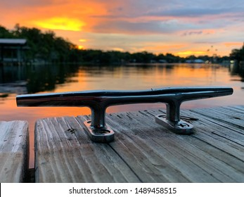 Boat dock cleat rope tie docking on the river with sunset