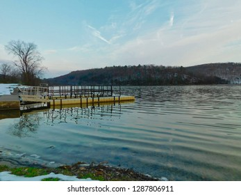 Boat dock at lake with the Appalachian mountains in the background.  Image taken at Aitch Boat Launch, Lake Raystown Region, Pennsylvania.