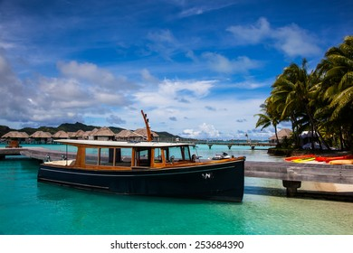 A Boat at a Dock on the Beach in Bora Bora