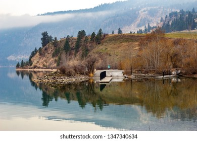 Boat dock on a calm fall morning in Vernon BC