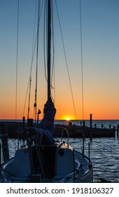 Boat at dock in Pamlico Sound at sunset on the Outer Banks, NC