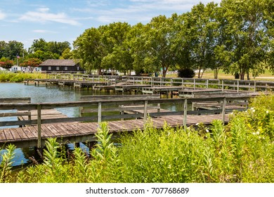 Boat dock and park office on the shore of Lake Trashmore, which is part of Mount Trashmore Park, a former landfill in Virginia Beach, Virginia, which was converted to a city park in 1974.