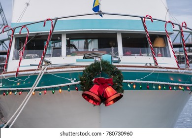 Boat Docked at Marina Adorned with Christmas Holiday Lights, Candy Canes, Wreath and Bells