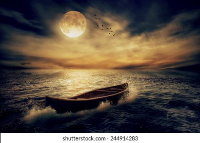 Boat drifting away in middle ocean after storm without course moonlight sky night skyline clouds background. Nature landscape screen saver. Life hope concept. Elements of this image furnished by NASA
