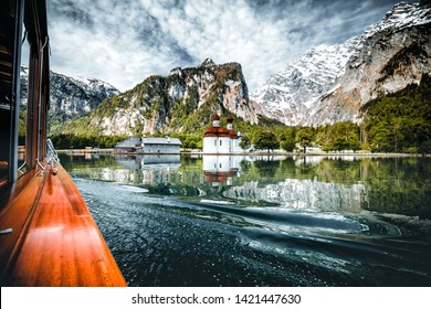 boat drive on the Königssee in Berchtesgaden in Germany Bavaria. a very beautiful lake with reflecting mountains in the water.