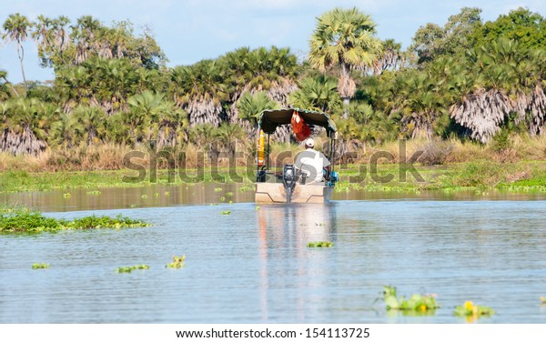 boat driver on the lake manze - national park selous game reserve in tanzania