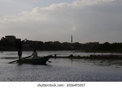 boat and fishermen