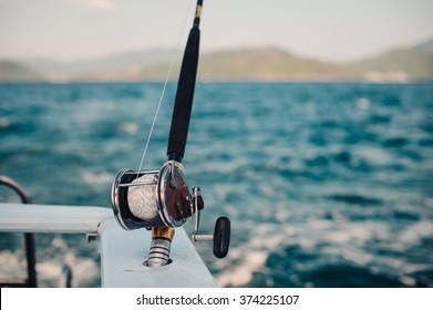 Boat fishing rods over a beautiful cloudy seascape horizontal
