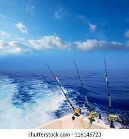 boat fishing trolling in deep blue ocean offshore in Mediterranean sea
