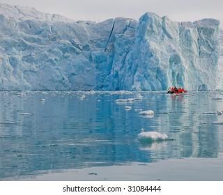 Boat in fjord with glacier, Arctic, Spitsbergen