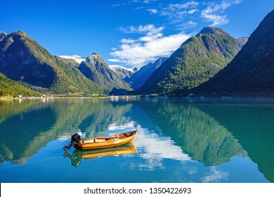 Boat, fjord and mountain. Amazing nature view. Beautiful reflection. Location: Scandinavian Mountains, Norway. Artistic picture Beauty world