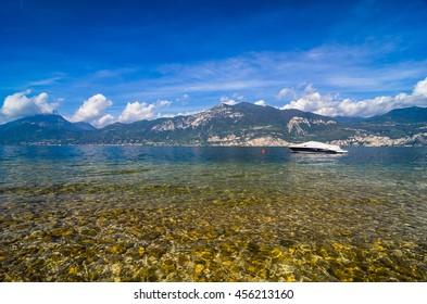 Boat floating at Garda lake