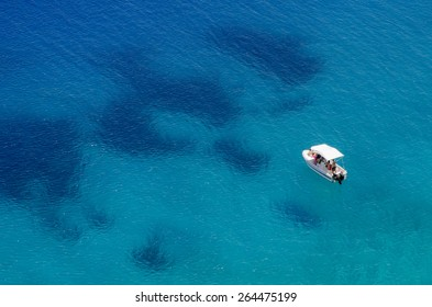 Boat floating in the middle of the Mediterranean Sea