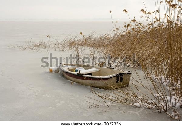 Boat in a frozen lake