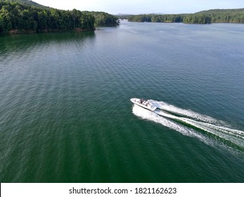 Boat at full throttle on the lake