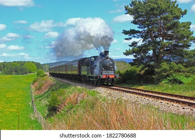 Boat of Garten, Badenoch and Strathspey, Scotland 05/16/2018 Caledonian Railway 812 Class 0-6-0 Number 828 at fisherman's Crossing near Broomhill Strathspey Railway.