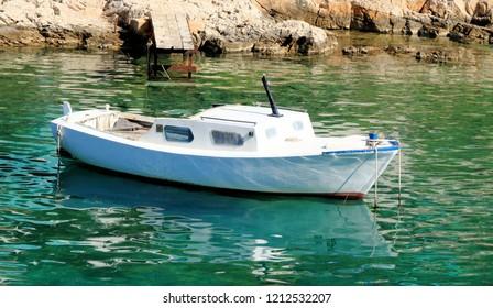 boat in the green blue water of the island Losinj, Croatia