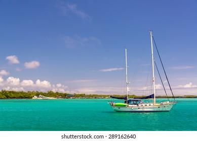 Boat in the harbor of Puerto Villamil at Isabela Island in the Galapagos Islands in Ecuador
