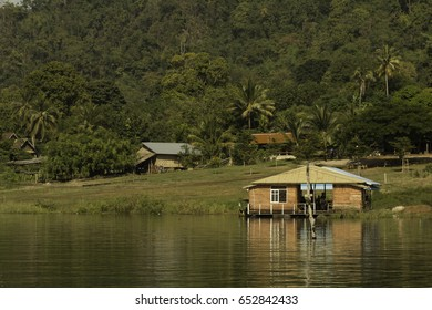 Boat house in the dam, surfers, rest and fishing