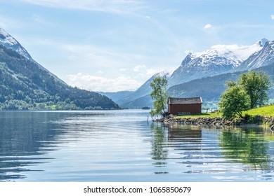 Boat house in lovely surroundings .  Photo taken on Flo in Oppstryn , in Norway .